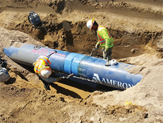 workers install a section of the water pipe